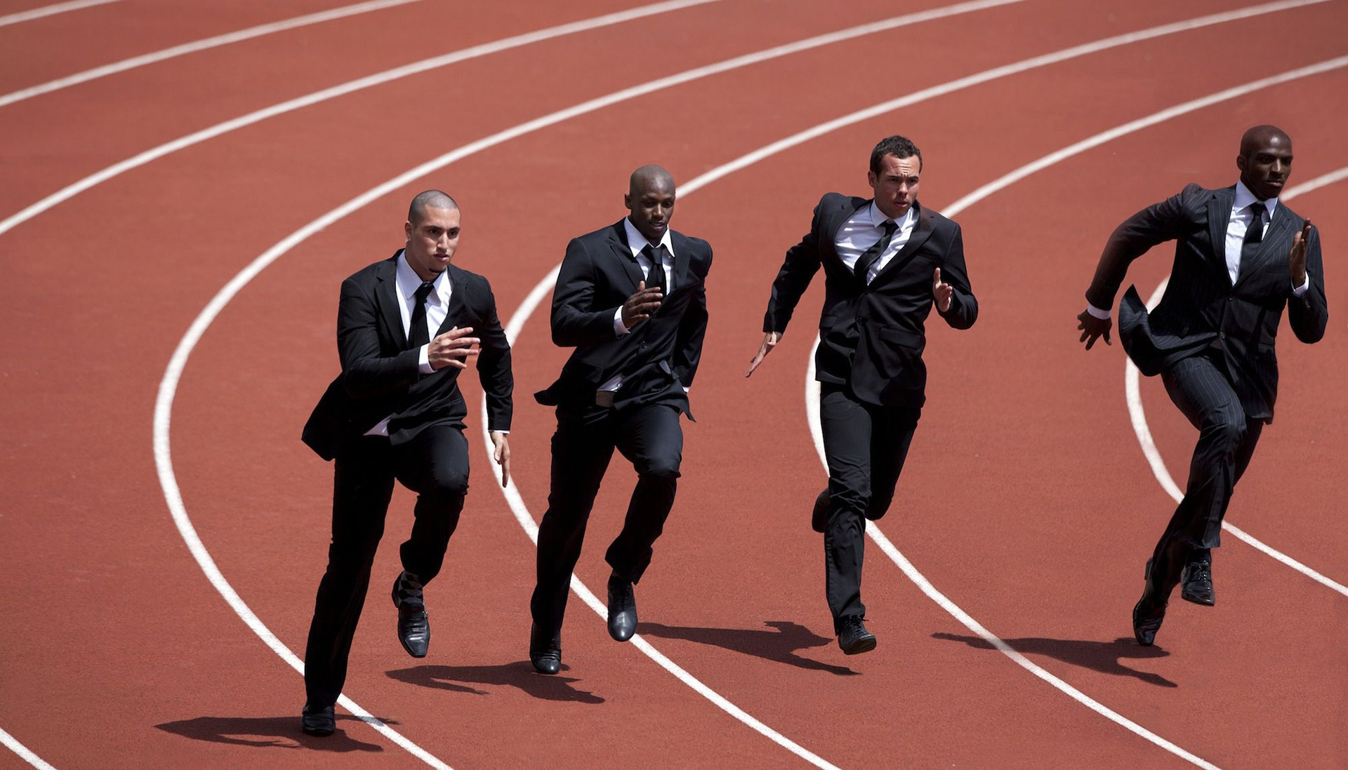 businessmen running on track